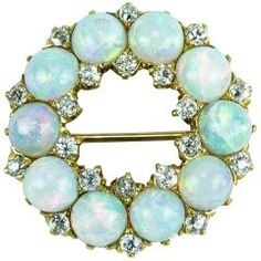 Exquisite Edwardian Circle of Fiery Opals accented by Diamonds and set in gold. Circa - Exquisite Edwardian Circle of Fiery Opals accented by Diamonds and set in gold. Sea Glass Jewelry, Wooden Jewelry, Opal Jewelry, Jewelry Shop, Fine Jewelry, Jewelry Design, Jewelry Stores, Diamond Jewelry, Gold Jewelry
