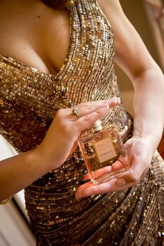 Golden glittery dress + Chanel perfume.
