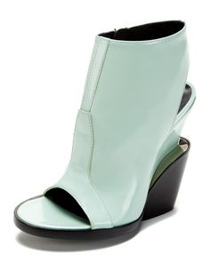 I would wear this bootie for the color alone. Emke Peep Toe Bootie