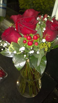 Everyone knows that red roses symbolize love! Here's a red rose bouquet for the bride. These will really stand out against her wedding dress!  americasflorist.com
