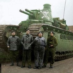 """the_ww2_memoirs Four crew members of a Char C2 super-heavy tank """"Poitou"""" belonging to the 51st Battalion, de Chars de Combat, pose for a photograph standing in front of their massive vehicle, Briery, France, October, 1939. The Char C2 was the largest tank ever produced and was originally designed for service during WW1 but never made it out onto the battlefield in time. It weighed 69 tons, had a crew of 12 (the same number of crew members the A7V had) and was over 10 meters long. It did see…"""