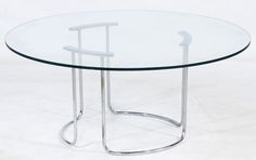 Lot 102: Mid-Century Modern Chrome and Glass Coffee Table; c.1970, having a thick round glass top on chrome base
