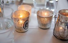 Vintage elegance with lace-decorated candles. Photo courtesy of SugarLove Weddings.