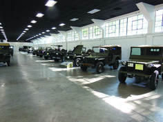 """A """"75th Anniversary of the Jeep"""" display was coordinated by Dave Aro who provided is very nice slat grill Willys. This featured one of each model and significant variation of U.S. jeep-type vehicles. Well not every one, but it was an excellent and educational line up. Notable and rare jeeps included a Willys MA from Jimmy Strauss, Bantam BRC-40s from Joe Garbarino and Helen Sauer, and the #14 of 15 Willys MT-Tug brought by Robert Schoen all the way from Montana. We worked on Dave and Jay…"""