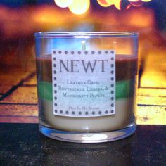Newt Scented 4 oz Candle: Leather Case, Bowtruckle Leaves, & Manuscript Papers