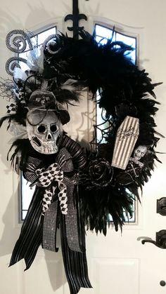 Halloween Wreath, Feather Wreath, Scary Skull Wreath, Day of Dead Wreath, Marti Gras Wreath, Harlequin Wreath by FrontDoorWhimsy on Etsy https://www.etsy.com/listing/246426081/halloween-wreath-feather-wreath-scary