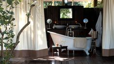 Outdoor bathtub. This site has 27 very creative decor ideas. Jyl, you would like these ideas!