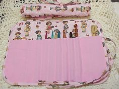 I just finished quilting this cute little dolls crochet hook holder. Check out all my holders in our ebay store.   Follow the link  http://www.ebay.com/itm/LITTLE-DOLLS-quilted-crochet-hook-case-holder-/400415200332?pt=LH_DefaultDomain_0=item5d3a9b144c