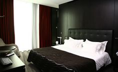 The Axis Viana Hotel has 88 rooms that incorporate materials like wood, stone, and leather. (Courtesy Axis Viana Hotel)