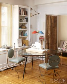 Midcentury French chairs in the dining area.