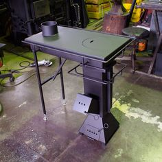 A desk with a stove; never seen anything like this.