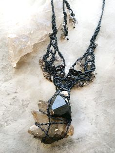 Crystal macrame necklace with Black Tourmaline on Smokey Quartz point cluster - www.spiritcarrier.com