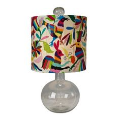 The Hunter lamp is quite a catch. A round clear glass base is topped off with a fabulously glam, Otomi fabric shade. The Otomi fabric is embroidered by artisans living in the mountains of Central Mexico. Hunter accepts one incandescent bulb and Home Decor Accessories, Decorative Accessories, Interior Design Guide, Ceramic Pendant, Lampshades, Diy Lampshade, Light Art, Light Table, Bulb