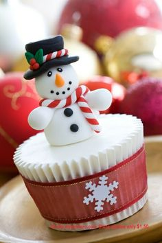 Christmas Snowman Cupcake; ribbon around the cupcake is cute
