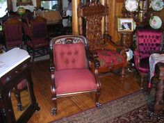 Dr. Arnold's mahogany carved, burgundy armchair in their home in San Francisco.