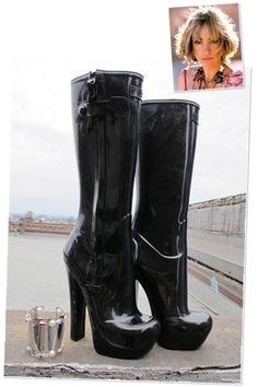 Dying for these boots. Technically, they're rain boots, but they're also perfect for adding a little kink to the everyday outfit. Louis Vuitton rain boots in black.