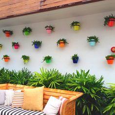 En la pared del balcon/baranda
