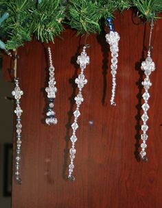 Wire and bead icicles. Curl the end, add some beads (smaller on the bottom), then curl the top of wire to make a hook. So pretty and easy for kids (if adult does wire work!)