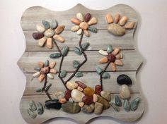 Next time you're at Michaels, buy some river rocks and copy this woman's gorgeous idea for your decor!