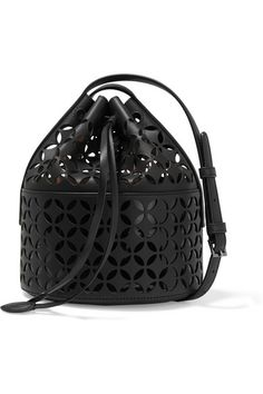 Alaïa's black leather bucket bag is crafted using the label's signature laser-cutting technique - contrasting the matte exterior with a glossy patent underlay. The drawstring silhouette is spacious enough to carry your wallet, diary and cell phone. Adjust the strap to wear it cross-body.