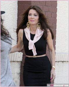lisa vanderpump, black dress, pink cardigan, gold hanging earrings, gold watch, nude belt #spring