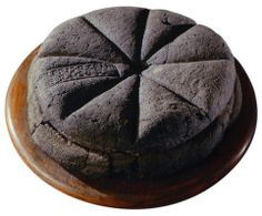 Photograph of a preserved circular loaf of bread discovered at Pompeii. That's pretty cool!