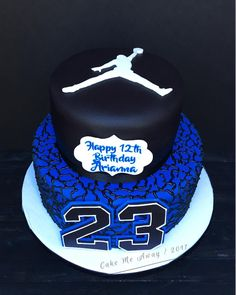 The top view for a Michael Jordan themed cake that I did for a 12th birthday party today. We did it in blue because it's the birthday girl's fave color. I loooove the elephant print from the Air Jordan's on the bottom tier.  So fun! Happy 12th birthday, Arianna!  #cakemeaway #cakemeawayfresno #blackandblue #michaeljordan #jumpman #jumpman23 #elephantprint #airjordan #12thbirthday #12thbirthdaycake #customcakes #fondantcake #birthdaycake #fondant #cakesart #cakestyle #cakedecorator #c...