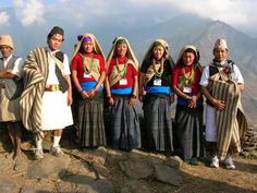 Nepal The Magars and Gurungs. Their traditional dress is very similar to each others. Women wear dark coloured sari with a bright yellow or blue cotton cloth wrapped around the waist (patuka) and a wrap-up blouse. The shoulders are covered with a shawl worn diagonally and another shawl is worn on the head. Men wear a wrap-on-knee-length loincloth (kachhad) with a short vest tied at the shoulders and a dhaka topi on their heads.
