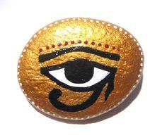 Gold Eye of Horus stone/paperweight by Ludibund on Etsy, $12.00