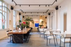 Fosbury & Sons Coworking Offices - Amsterdam | Office Snapshots Co Working, Working Area, Amsterdam, Steel Frame Doors, Old Hospital, Wooden Desk, Coworking Space, Contemporary Artwork, Belgium