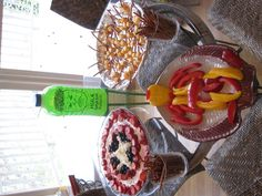 Avengers party food--Capt America fruit salad, Thor's hammers, Hulk Punch, Iron Man peppers, and Hawkeye's arrows (pretzels).
