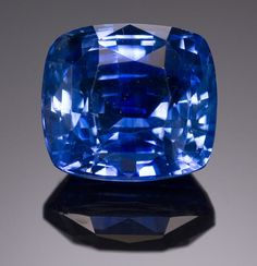 Sapphire  Sri Lanka   Characterized by its attractive rich cornflower blue hue, this cushion-cut gem displays excellent luster.   Weighing approximately 5.16 carats and measuring 9.45 x 8.5 x 6.3mm.