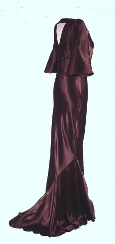 1935 brown satin, bias-cut evening dress with machine-stitched quilted decoration.  The boyish figure of the 1920s was replaced in the 1930s by more feminine curves revealed by close-fitting styles.  This was achieved by cutting the fabric on the bias and diagonal seaming.