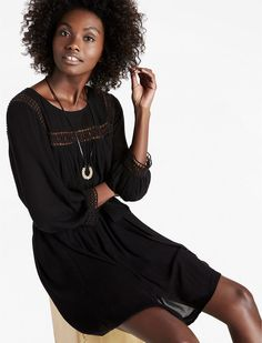 This is a sweet little dress! Geo Lace Insert Dress - A little black dress with geometric lace trim exudes modern romance for everyday, featuring a belted waist and back button closures. Afflink