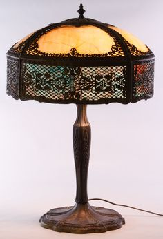 Lot 191: Art Nouveau Slag Glass Table Lamp; c.1930, brown and blue slag glass panels, floral motif