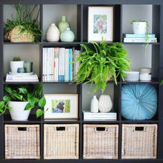 Bookshelf styling ideas - fill some pockets with baskets, others with magazines, create a stack of books and put a tray on top filled with candles and indoor plants...