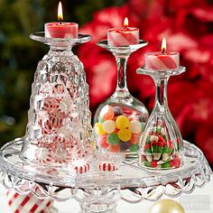 Christmas Decorating Ideas ~ Love this clever centerpiece idea! Turn glasses upside, fill with greenery or candy, and then place a tealight on top!