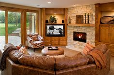 window, tv, fireplace...curved couch. Traditional Basement by Pillar Homes