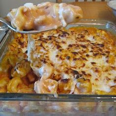 1 bag of frozen cheese filled tortellini 1 jar of alfredo sauce 1/2 jar of marinara sauce 1/2 cup shredded mozzarella 1/2 cup grated Parmesan cheese Preheat the oven to 350. Cook the tortellini according to package directions. Mix with the sauce and in an baking dish. Top with mozzarella and parmesean. Bake for fifteen minutes. Then broil for five minutes.