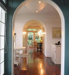 love the tall arches and open space. Love the blue in first room, too.