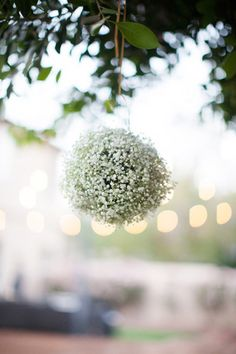 Babies breath flower ball with a pink ribbon