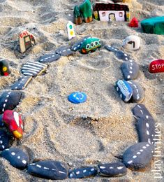 Paint rocks as road or tracks to keep in the sandbox.