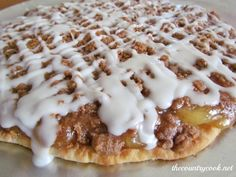 Easy Apple Dessert Pizza  1 premade thin pizza crust   1 can apple pie filling  4 tbsp. butter, softened to room temperature  2/3 cups brown sugar  2/3 cups all-purpose flour  1/2 tbsp. cinnamon    For the icing:  2 cups powdered sugar  2-3 tbsp. milk  1 tbsp. melted butter  350 for 25-30 min