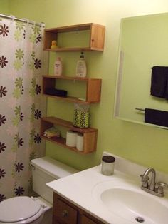 Bathroom remodeling is done » Curbly   DIY Design Community  Great storage idea without blocking access to toilet tank or looking too bulky for small bathroom