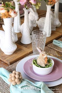 A beautiful and soft Easter table decor setting that is the perfect transition into spring. Soft whites with pops of flowers and pastels makes this Easter table setting perfect for your family! Check out more of this table on http://ablissfulnest.com