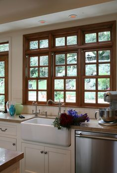 wood window with white cabinets