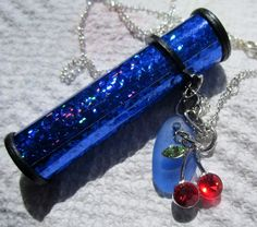 kalidescope cornflower blue beach glass necklace....this is a working kalidescope 2nd picture shows design