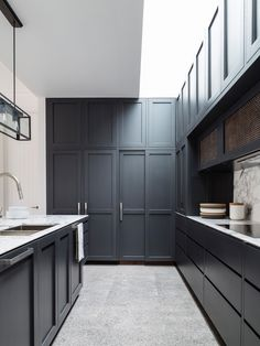 Kitchen cabinets. Colour.  A home with a comfortable mix of traditional and contemporary elements