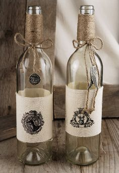 "Make these using empty wine bottles and fresh new corks for gifts Stamp on Burlap Burlap Wrapped 13"" Glass Bottles with Charms (2 bottles) $14.99"