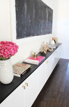 madebygirl's old house wall mounted console (I think) IKEA could help get something similar.  Chalkboard painted wood would look like slate if you chalk and then erase it.